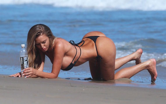 51810676 Canadian Model and Playboy Playmate Charlie Riina shows off her bikini body during a photo shoot for a 138 Water in Malibu, California on July 28, 2015. FameFlynet, Inc - Beverly Hills, CA, USA - +1 (818) 307-4813