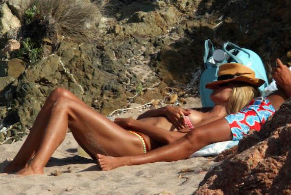 Heidi Klum topless - candids in Italy