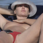 Bleona Qereti - topless & lip slip on the beach in Sardinia